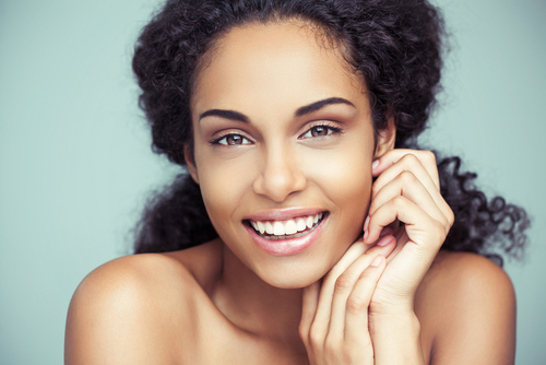 beautiful curly-haired woman smiling